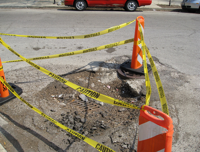 Pothole, road construction in Kingston