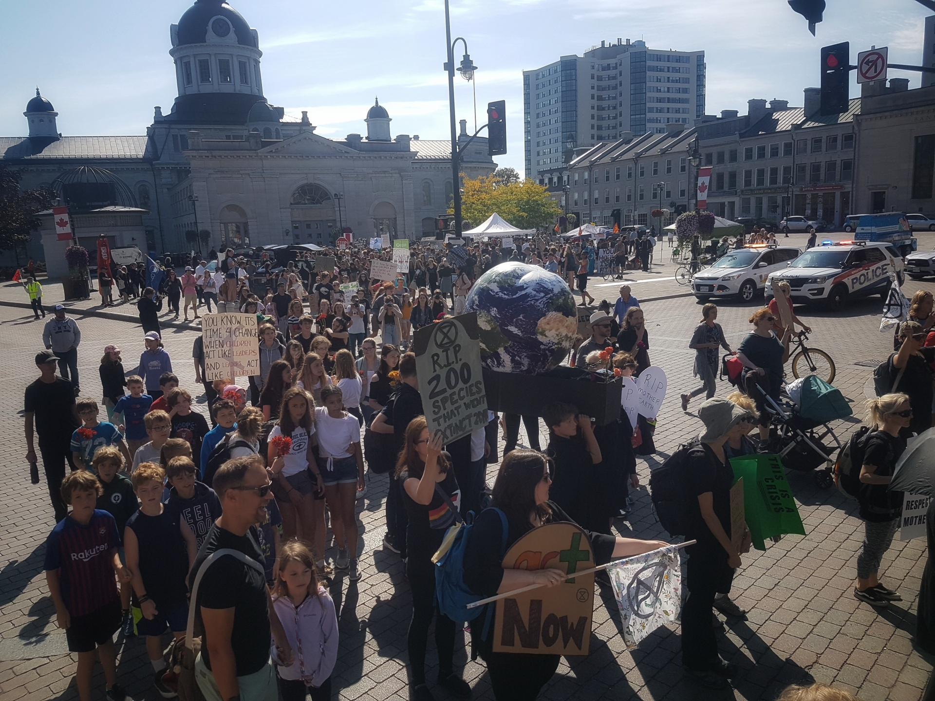 Kingston students take to the street to strike for climate action