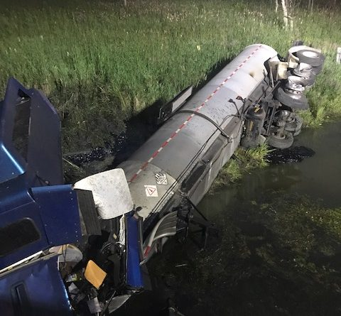 Tractor trailer rollover causes spill, 401 closure